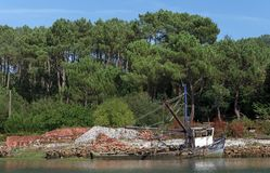 Old Oyster boat in Crac`h river banks Royalty Free Stock Photos