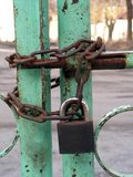 Old padlock. Green gate, chain and padlock Royalty Free Stock Photography