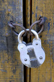 Old padlock. Closing old wooden door stock photography