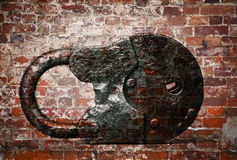 Old padlock on background of brick wall Stock Images