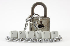 Locked spelled, padlock and chain Stock Photo