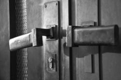 Old padlock on a door stock photography