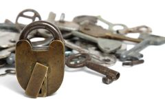 Old padlock and heap keys isolated Royalty Free Stock Photos