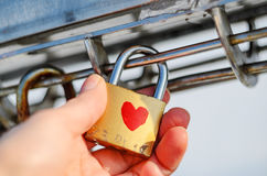 Old padlock with heart pattern on the palm Stock Image