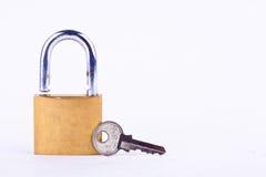 Old padlock and key on white background tool isolated Stock Image