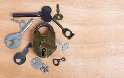 Old padlock and keys on wood Royalty Free Stock Image