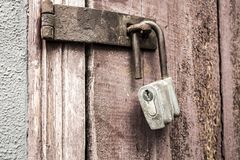 Old padlock. On a background of a wooden door Royalty Free Stock Photos