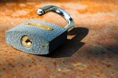 Old padlock on rust. Y orange table with blurry background royalty free stock photos