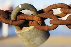 Old padlock on rusty chain Royalty Free Stock Photography