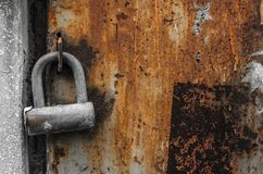 Old padlock on old rusty wall stock image