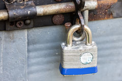 Old padlock secured door Stock Photography