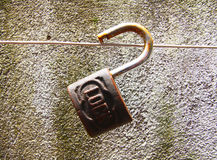 Old padlock with time Stock Images