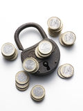 Old padlock on white background. With euro coins Stock Photos