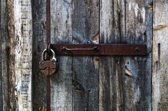 Old padlock. On a wooden door Royalty Free Stock Photo