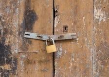 Old padlock on a wooden door. Old padlock on a  wooden  door Stock Photo