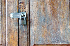 Old padlock on a wooden door Stock Images