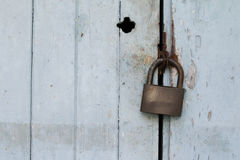 Old padlock on wooden door Royalty Free Stock Photography