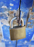Old padlock on a wooden door Royalty Free Stock Image