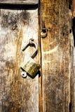 Old padlock on wooden door Stock Photography