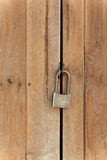 Old padlock on wooden door Royalty Free Stock Photos