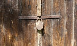 Old padlock on wooden door Royalty Free Stock Image