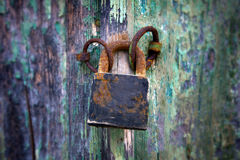 Old padlock on a wooden door Royalty Free Stock Images