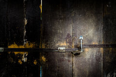 Old padlock on a wooden door - Security Concept Stock Images