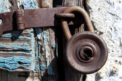 Old padlock. On a wooden door texture Stock Photos