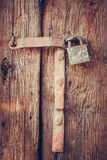 Old padlock on a wooden door Stock Photos