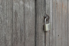 Old padlocked on wooden door Royalty Free Stock Photos