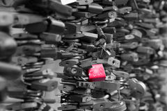 Old Padlocks At A Bridge. Old Love Locks a modern symbol of love to a bridge black and white photo royalty free stock images