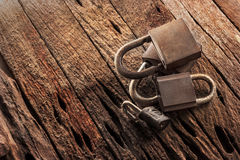 Old padlocks  on grunge wood background. Stock Photo