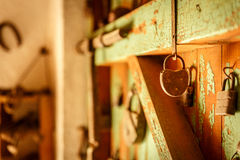 Old padlocks placed on an old wooden door. Old padlocks placed on an old and decayed wooden door Stock Photos