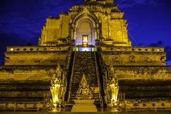 Old pagoda and golden buddha statue Royalty Free Stock Photography