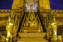 Old pagoda and golden buddha statue Stock Images