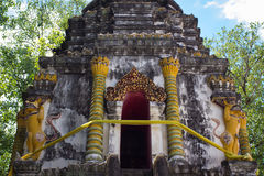 Old pagoda and imaginary animal on wall in thailand Royalty Free Stock Photography