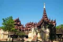 Old pagoda teak wood of Shwe In Bin Kyaung monastery. Mandalay, Myanmar. Old pagoda teak wood of Shwe In Bin Kyaung monastery a sunny day. Mandalay, Myanmar stock photos