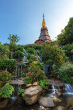 Old Pagoda and water fall at Doi Inthanon. Royalty Free Stock Image