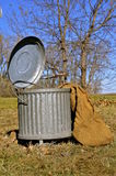 Old pail with lid for storing chemicals and hazardous materials. A galvanized pail for storing wastes, hazardous materials, and chemicals has an attached lid and Stock Photos