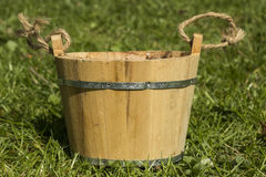 Old pail. Rustical pail on the grass stock images