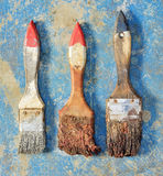 Old paint brush on the floor Royalty Free Stock Images