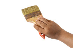 Old paint brush. Male hand holding an old paint brush on white background Royalty Free Stock Image