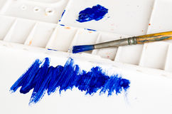 Old paint brush and palette. With blue scratch Stock Photos