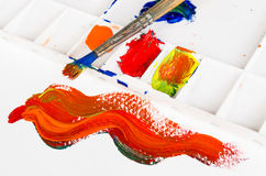 Old paint brush and palette. With warm tone colour Stock Photos