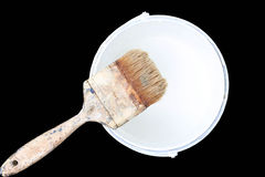 Old paint brush rest on top of  paint tin isolated Stock Images
