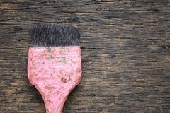 Old paint brush rests on a brown wooden floor and have copy spac. E for design Concept in your work Stock Photos