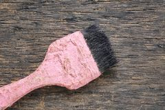 Old paint brush rests on a brown wooden floor and have copy spac. E for design Concept in your work Royalty Free Stock Images