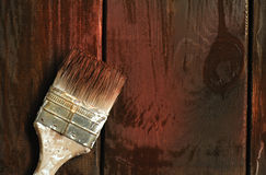 Old paint brush on a wooden background Stock Photo
