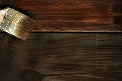 Old paint brush on a wooden background Stock Photos