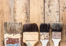 Old paint brushes on wooden table. Background Royalty Free Stock Photography